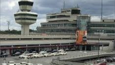 Berlin Tegel Airport – Arrivals & Departures on skyline (Tegel is located behnd Tempelhof Control Tower)